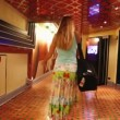 Blond passenger womwalking along CostConcordicruise ship corridor — Stock Video #14807233