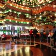 Stock Video: Passengers of Costa Concordia cruise ship relaxing at the elegant lobby bar