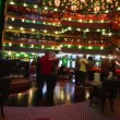 Stock Video: Passengers of Costa Concordia cruise ship amusing and dancing in the lobby