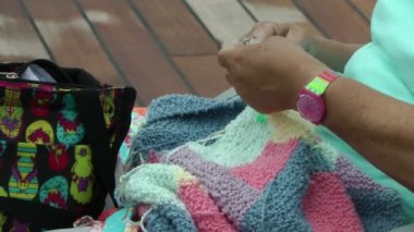 Woman's hands knitting a colorful blanket — Wideo stockowe