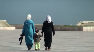 Two Muslim women and little girl on square near Hassan II Mosque — Stock Video