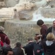Stock Video: Trevi Fountain, Rome, and many many tourists