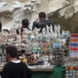 Stock Video: Trevi Fountain, souvenirs stall, tourists and Police car