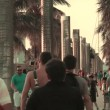 Tourists and vacationers along South Pointe Park Pier, Miami Beach — Stock Video #39611625