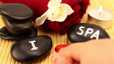"""I love spa"" scene made of black spa therapy stones — Stock Video"