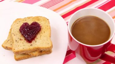 A breakfast scene with a heart of red jam. Be my valentine — Vidéo