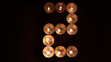 Digits made of candles — Stockvideo
