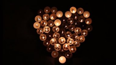Heart shape made of candles — Stock Video
