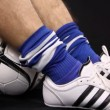 Stock Video: Football, soccer player shoe and ball, close up