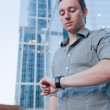 Stock Photo: Man checking the time