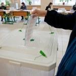 Woman put election ballot into the box — Stock Photo #13898926