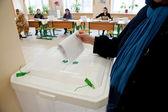 Woman put election ballot into the box — Stock Photo