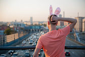 Adult guy with rabbit ears — Stock Photo