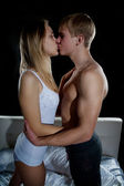 Young girl and boy kissing — Stock Photo