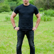 Stock Photo: Min black t-shirt stands on grass