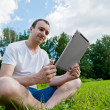 Man with tablet pc in the park — Stock Photo #27652875