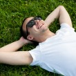 Man lying on the grass — Stock Photo