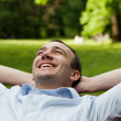 Smiling man sitting on the bench — Stock Photo