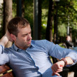 Man checking the time in the public garden — Stock Photo
