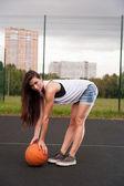 Sexy Woman Holding Basketball In Hand — Zdjęcie stockowe