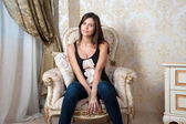 Young pregnant woman sits on chair at home — Photo