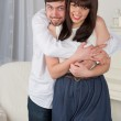 Couple embrace each other at home — Stock Photo