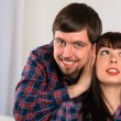 Young man close ears his girlfriend. Couple portrait — Stock Photo