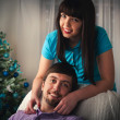 Couple at Christmas. Happy Smiling Family at home celebrating. N — Zdjęcie stockowe #37570585