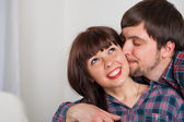 Portrait of young love couple at home. Kissing moments — Stock Photo