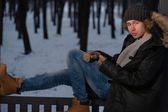 Man sitting in the winter park — Stock Photo