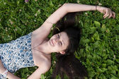 Girl relaxing on grass — Stockfoto
