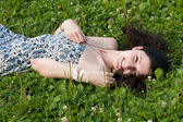 Girl relaxing on grass — Stock Photo
