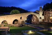 Stone bridge on Camprodon town in the night — Stock Photo