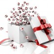 Gift box emitting little gift boxes — Stock Photo