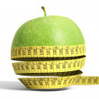 Royalty-Free Stock Photo: Apple with tape measure