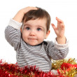 Stock Photo: Eight months baby inside a box with christmas ornaments