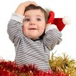 Eight months baby inside a box posing with a Santa hat — Stock Photo