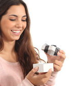 Teen girl smiling opening a gift box — Stock Photo