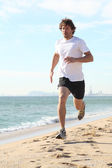 Man running in the beach — Stock Photo