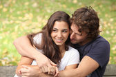 Couple hugging in a park — Stock Photo