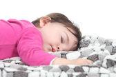 Baby sleeping on a blanket — Stock Photo
