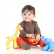 Baby playing with colorful toys — Stock Photo #19907715
