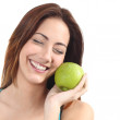 Beautiful woman holding a green apple close to her face — Stock Photo #22023315