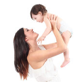 Beautiful mother raising her daughter looking with tenderness — Stock Photo