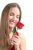 Beautiful woman with a red rose — Stock Photo