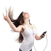 Beautiful woman dancing and listening to the music with headphones — Stock Photo