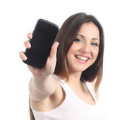 Happy woman showing a black mobile phone screen — Stock Photo
