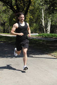 Sportsman running on a park — Stock Photo