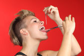 Woman piercing the tongue herself — Stock Photo