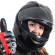 Happy biker woman with a road helmet and thumb up — Stock Photo
